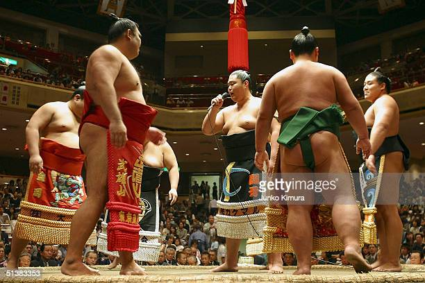 Sumo wrestlers sing for the retirement of Hawaiianborn former grand champion or yokozuna Musashimaru during his topknot cutting ceremony on October 2...