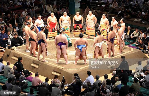 Sumo wrestlers stand around the ring during the Grand Sumo Technical Examination Tournament at Ryogoku Kokugikan on May 8 2011 in Tokyo Japan After...