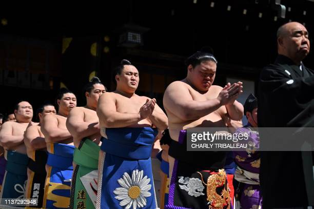 """Sumo wrestlers take part in a traditional ring-entering ceremony as part of a """"honozumo,"""" a ceremonial sumo exhibition, on the grounds of Yasukuni..."""