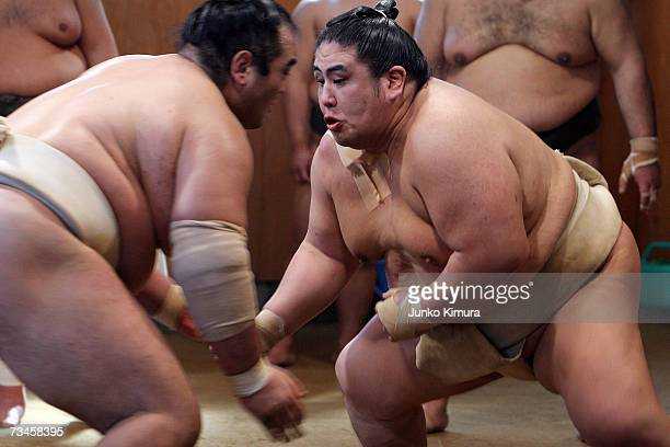 """Sumo wrestlers take part in a training session during a """"Sumo Diet Campaign"""" event at Musashigawa Sumo Stable on March 1, 2007 in Osaka, Japan. The..."""