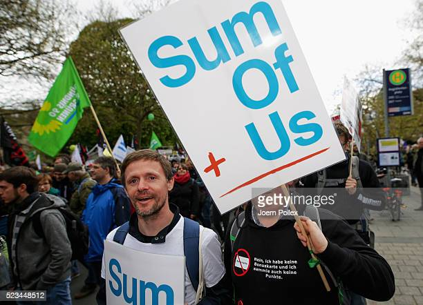 SumOfUs Activists protest during an AntiTTIP Demonstration on April 23 2016 in Hanover Germany People protest against the reducing of the regulatory...