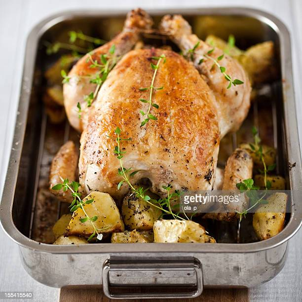 Sumptuous roasted chicken with herbs and potatoes