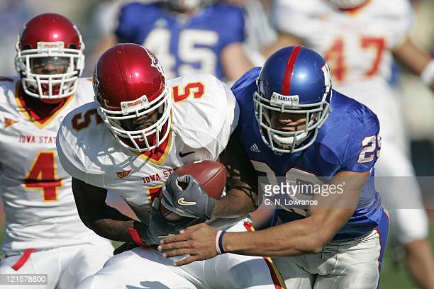 Sumrall of the Iowa State Cyclones attempts to break free from Jon Cornish during a punt return against the Kansas Jayhawks during 1st half action at...