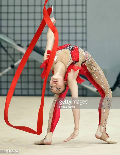 Sumure Kita a member of Japan women's rhythmic gymnastics team known as Fairy Japan practices in Tokyo on July 24 exactly a year before the opening...