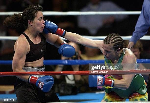 Sumya Anani lands a punch on Lisa Holewyne during their sixround Women's Junior Welterweight Bout at Staples Center April 24 2004