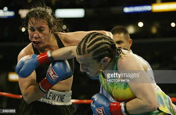 Sumya Anani launches a right hand on Lisa Holewyne during the Women's Junior Welterwright underscore bout at the Staples Center in Los Angeles 24...