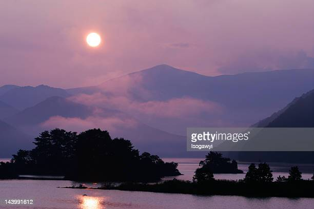 sun above lake - isogawyi stock pictures, royalty-free photos & images