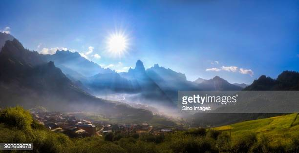 sun above mountain village,  gannan, gansu, china - gansu province stock pictures, royalty-free photos & images