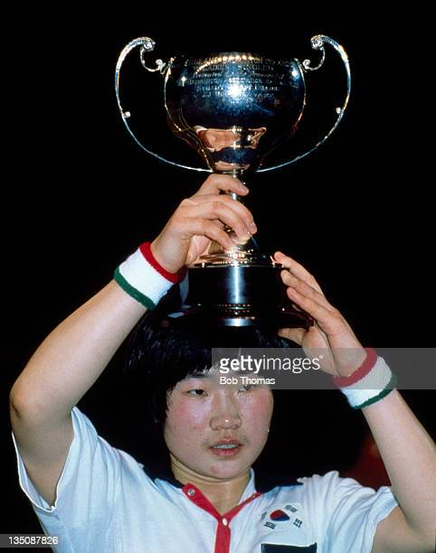 Sun Ai Hwang of Korea with the trophy after winning the Women's All England Badminton Championship at Wembley Arena in London circa March 1991