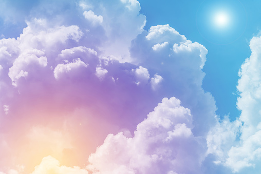 Sun and cloud background with a pastel colored 967091454