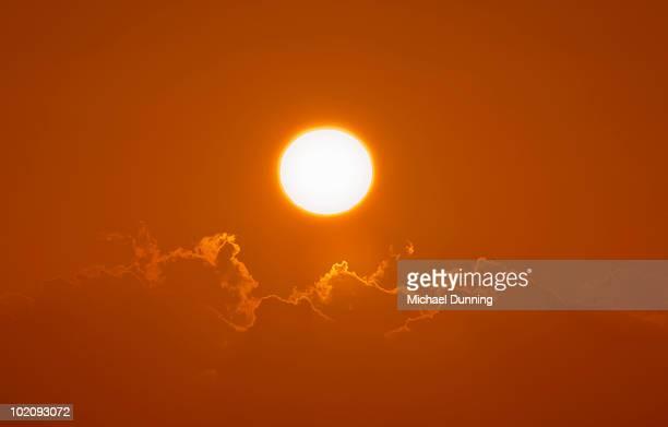 sun and clouds - dawn dunning stockfoto's en -beelden