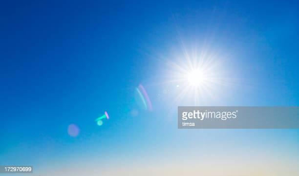 Soleil et lens flare arrière-plan