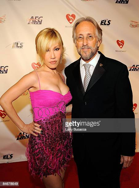 Sun and president and CEO of The Recording Academy Neil Portnow arrive at the 2009 MusiCares Person of the Year Tribute to Neil Diamond at the Los...
