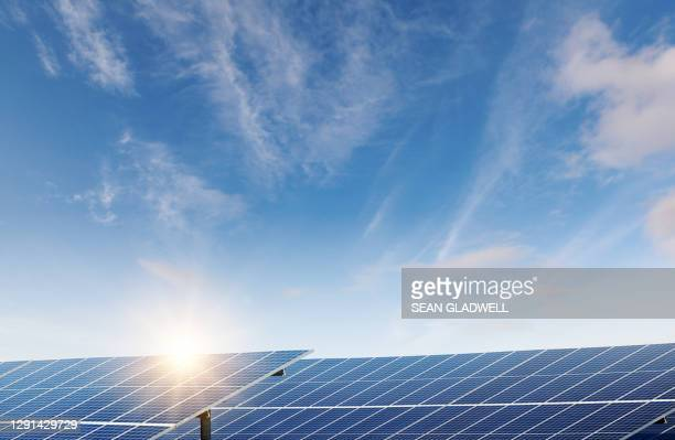 sun and solar panels - power supply stock pictures, royalty-free photos & images