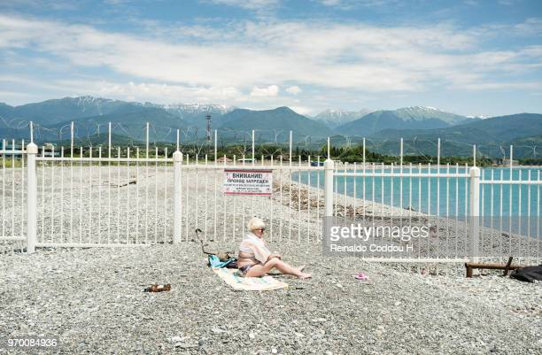 A boy dives into the Black Sea in front of Fisht Stadium on June 25 2018 in SOCHI Russia