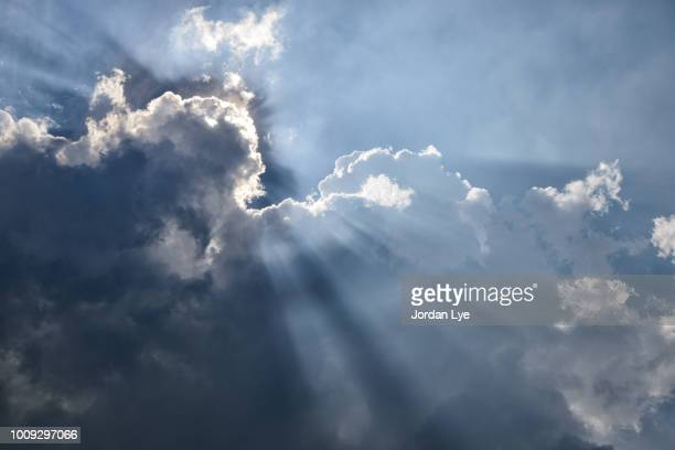 sun beam through the clouds - god stock pictures, royalty-free photos & images