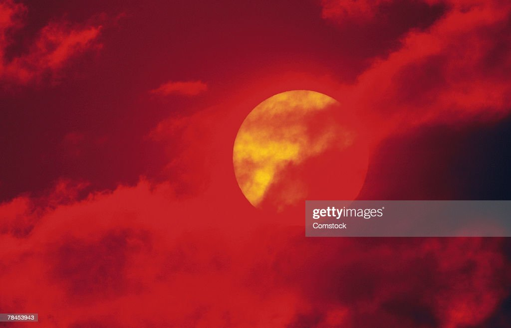 Sun behind clouds : Stock Photo