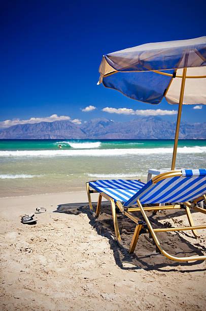 Sun Chairs And Umbrella On Beach Wall Art