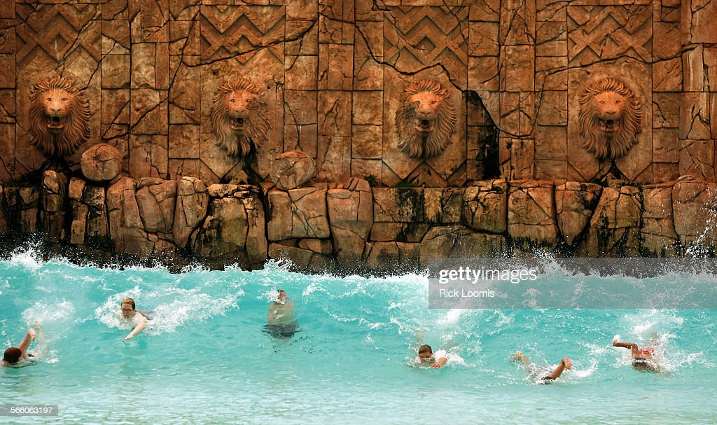 Sun City, South Africa -- A large wave pool thrills body surfers at the water park in Sun City, one : News Photo