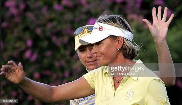 Sun City, SOUTH AFRICA: Sweden's Annika Sorenstam and her partner Liselotte Nuemann celebrate after winning the second edition of Women's Golf World...