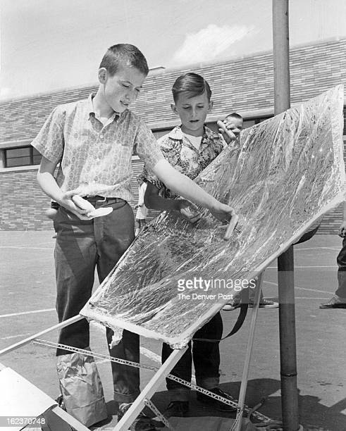 MAY 24 1959 MAY 25 1960 Sun Cooks For Them Mark Walbaum 6th grader at Carson School demonstrates the practical uses of the solar oven he built with...