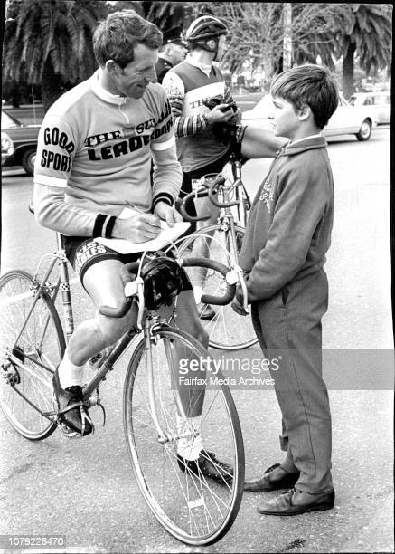 Sun Cycle Tour Sub Juvenile champion Patrick O'Brien gets an autograph and few hints from Sun tour leader Keith Oliver at Dubbo September 25 1969