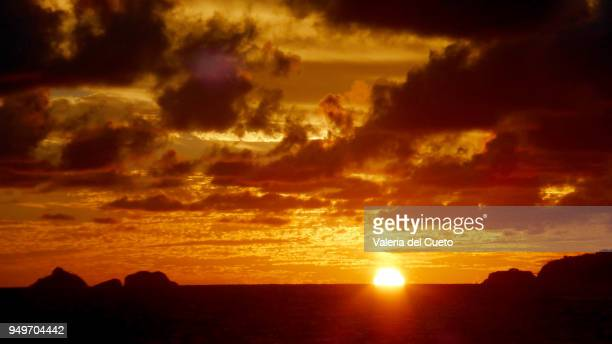 Sun falling on the sea between Tijucas Islands  and Joa Point