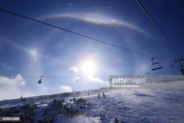Sun halo above the lifts of Bansko ski resort