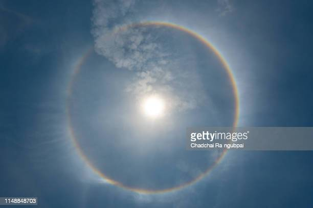 sun halo in the sky. the sun halo is circle around the sun or the moon made from ice crystals in the sky. it is rare phenomenon - light natural phenomenon stock photos and pictures