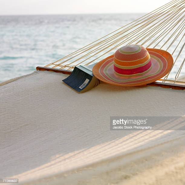 Sun hat and book on hammock