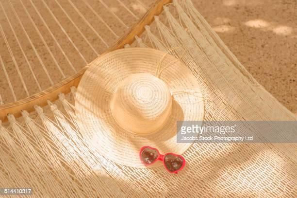 Sun hat and sunglasses in hammock