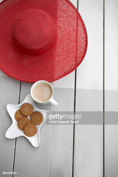 sun hat, tea and biscuits - heidi coppock beard stock pictures, royalty-free photos & images