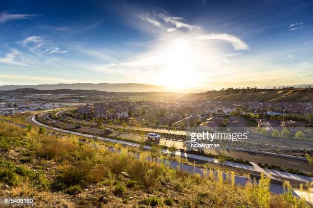 sun hits horizon behind american suburb - santa clarita stock photos and pictures
