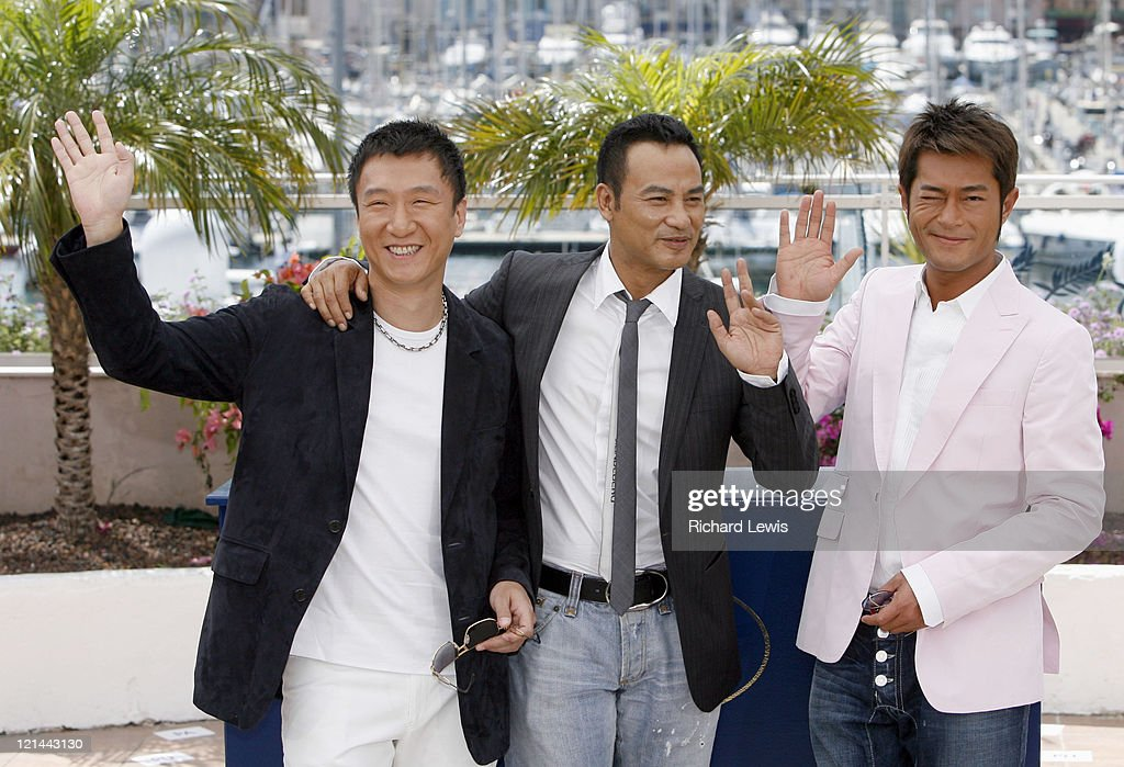 Sun Hong Lei, Simon Yam and Louis Koo during 2007 Cannes Film Festival - 'Triangle' Photocall at Palais de Festival in Cannes, France.