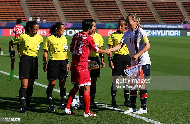 Sun Hui of Korea DPR and Kristine Hegland of Norway exchange pennant before the FIFA U-20 Women's World Cup 2012 group C match between Korea DPR and...
