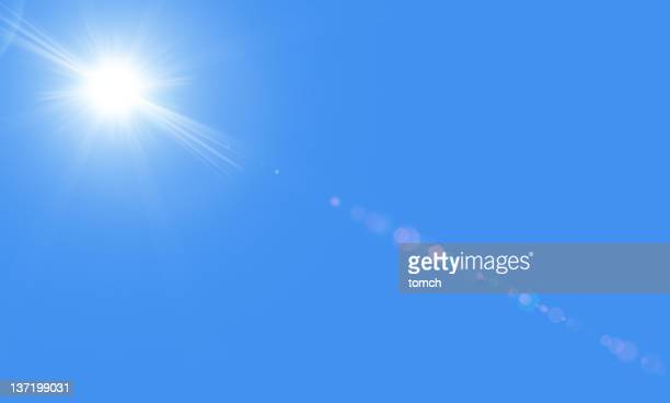 sun in the blue sky with lensflare - lens flare stock pictures, royalty-free photos & images