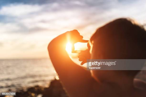 sun in the frame - calculating stock pictures, royalty-free photos & images