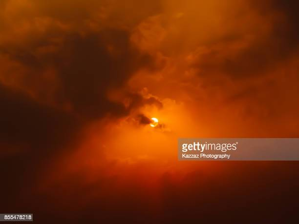sun in the middle of clouds - hell stock pictures, royalty-free photos & images