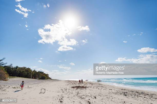 Sun in the sky at Varadero beach White sand beach and frothy blue sea water on a sunny day