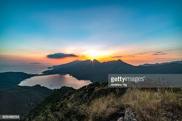 sun is behind the mountain - lantau stock pictures, royalty-free photos & images
