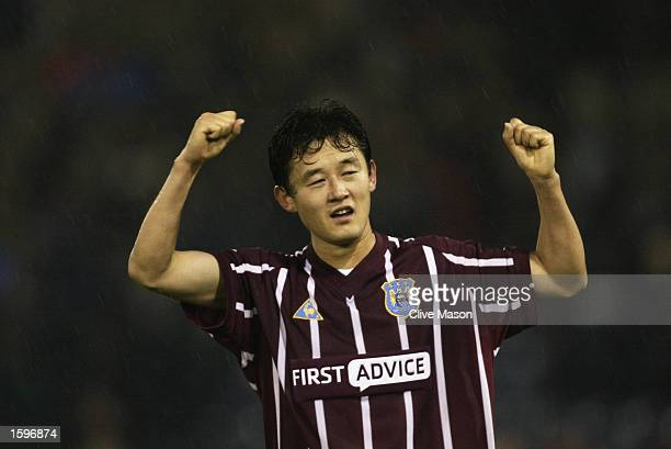 Sun Jihai of Manchester City celebrates victory after the Barclaycard Premiership match between West Bromwich Albion and Manchester City at the...