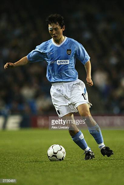 Sun Jihai of Manchester City runs with the ball during the UEFA Cup second round first leg match between Manchester City and Groclin Dyskobolia held...