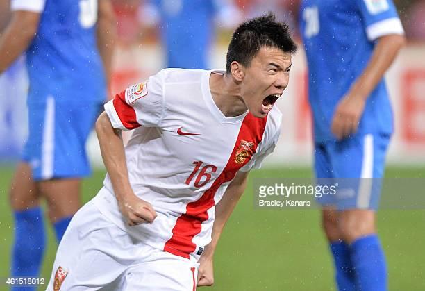 Sun Ke of China celebrates after scoring a goal during the 2015 Asian Cup match between China PR and Uzbekistan at Suncorp Stadium on January 14,...