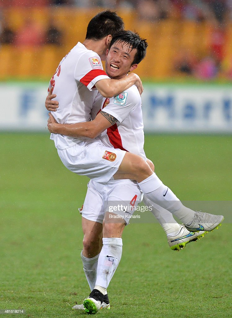 Sun Ke of China celebrates scoring a goal with team mate Jiang Zhipeng of China during the 2015 Asian Cup match between China PR and Uzbekistan at Suncorp Stadium on January 14, 2015 in Brisbane, Australia.