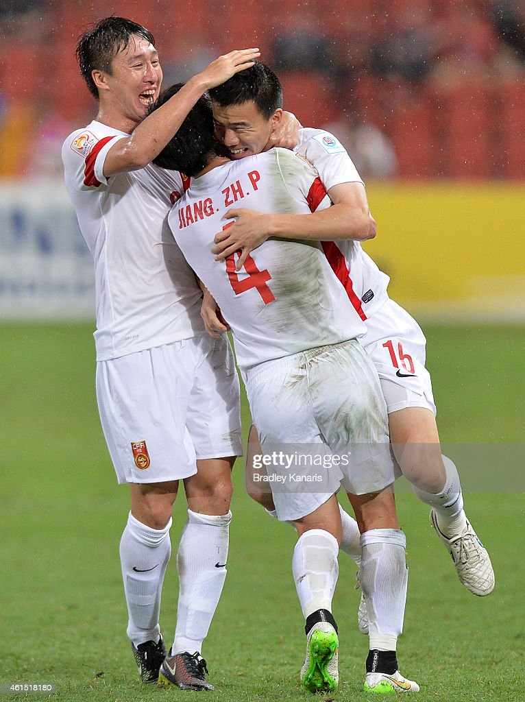 Sun Ke of China celebrates scoring a goal with team mates during the 2015 Asian Cup match between China PR and Uzbekistan at Suncorp Stadium on January 14, 2015 in Brisbane, Australia.