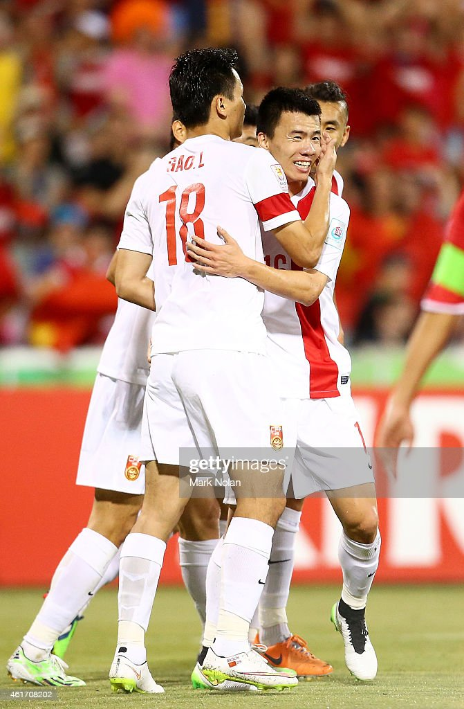 Sun Ke of China celebrates with team mates after scoring a goal during the 2015 Asian Cup match between China PR and DPR Korea at Canberra Stadium on January 18, 2015 in Canberra, Australia.