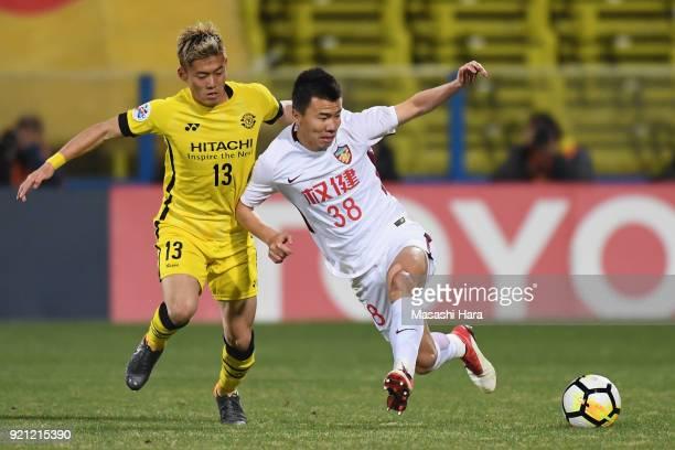 Sun Ke of Tianjin Quanjian and Ryuta Koike of Kashiwa Reysol compete for the ball during the AFC Champions League match between Kashiwa Reysol and...