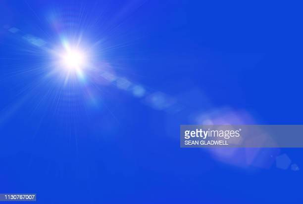 sun lens flare blue sky - lens flare stock pictures, royalty-free photos & images