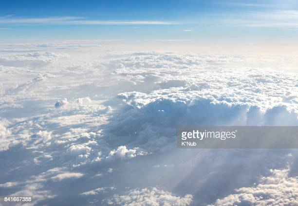 sun light beam pass through the cloud from plane, above, view - elysium stock pictures, royalty-free photos & images