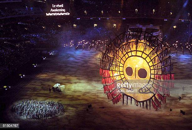 A sun lights up the grounds of the Olympic Stadium during the 'Djakapurra clans Wandjina' segment of the opening ceremony of the 2000 Summer Olympics...